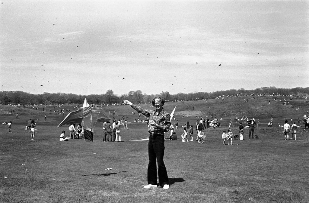 A person flying a bird kite.